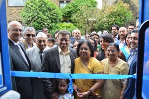 Mahesh Ramniklal Shah & Family led the opening of the doors,